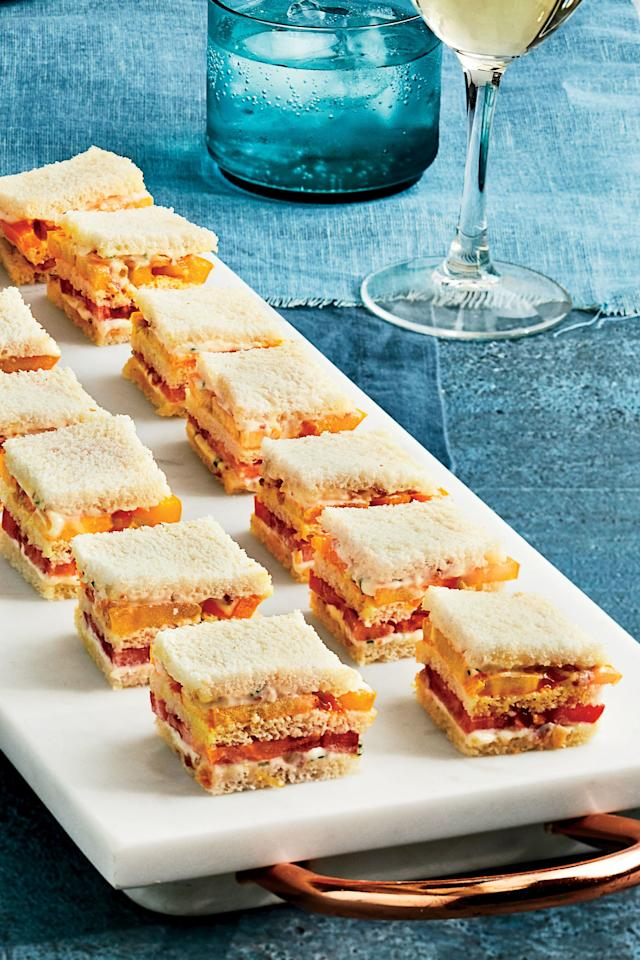 "<p><strong>Recipe: <a href=""https://www.southernliving.com/recipes/mini-tomato-sandwiches-bacon-mayonnaise-recipe"">Mini Tomato Sandwiches With Bacon Mayonnaise</a></strong></p> <p> The ideal easy to put together finger sandwich for your next lunchtime meal.</p>"