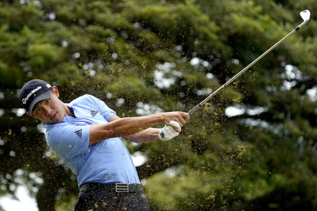Collin Morikawa hits from the fourth tee during the third round of the Sony Open PGA Tour golf event, Saturday, Jan. 11, 2020, at Waialae Country Club in Honolulu. (AP Photo/Matt York)