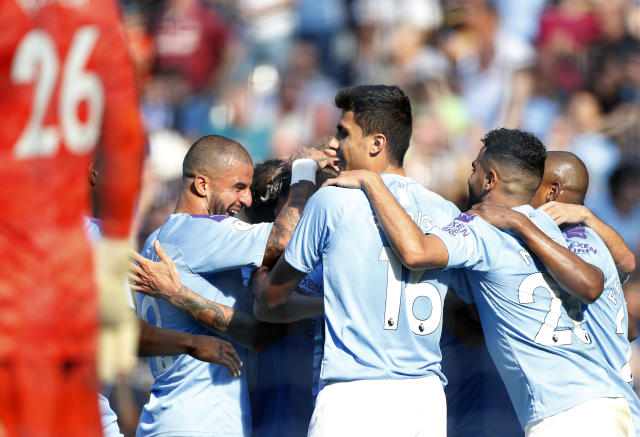 Manchester City's players celebrate after scoring their sides fifth goal during the English Premier League soccer match between Manchester City and Watford at Etihad stadium in Manchester, England, Saturday, Sept. 21, 2019. (AP Photo/Rui Vieira)