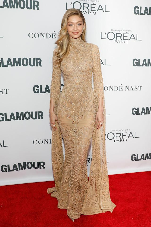 <p>Gigi Hadid stunned in a Zuhair Murad gold embroidered full-length gown with long split-sleeves and high-neck.</p>