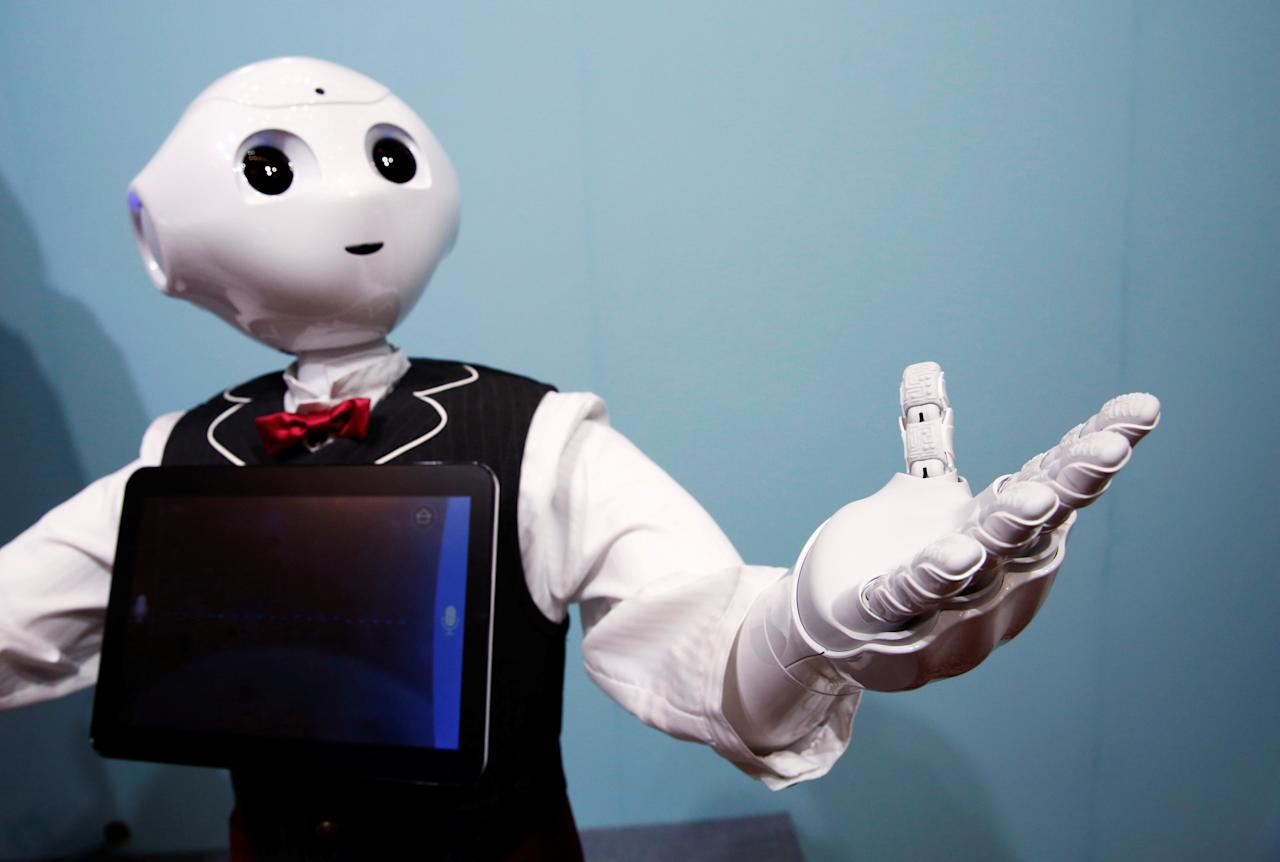 SoftBank humanoid robot known as Pepper dressed as a waiter moves its hand at Pepper World 2016 Summer during SoftBank World 2016 conference in Tokyo, Japan, July 21, 2016.  REUTERS/Kim Kyung-Hoon