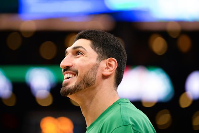 After blaming James Dolan for the Knicks' struggles in free agency in September, Enes Kanter gave Dolan a hug on Sunday at Madison Square Garden. (Kathryn Riley/Getty Images)