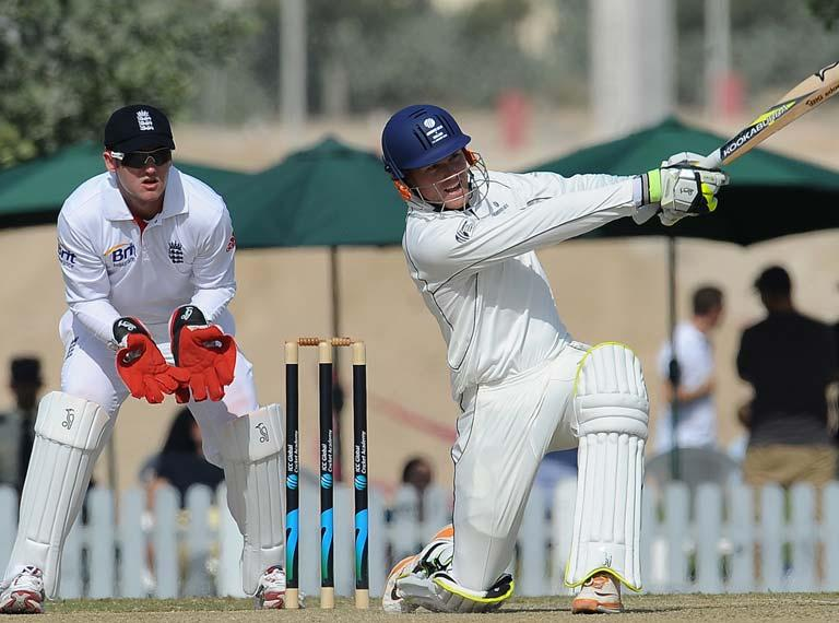 England XI wicket keeper Steven Davies (L) watches ICC Combined Associate and Affiliate XI cricketer Christi Viljoen (R) playing a shot during the opening day of a three-day practice match between the England XI and ICC Combined Associate and Affiliate XI at The ICC Global Cricket Academy in Dubai Sports City on January 7, 2012. England plays three Tests, four one-day internationals and three Twenty20s against Pakistan in the United Arab Emirates between January 17 and February 27.  AFP PHOTO/Lakruwan WANNIARACHCHI