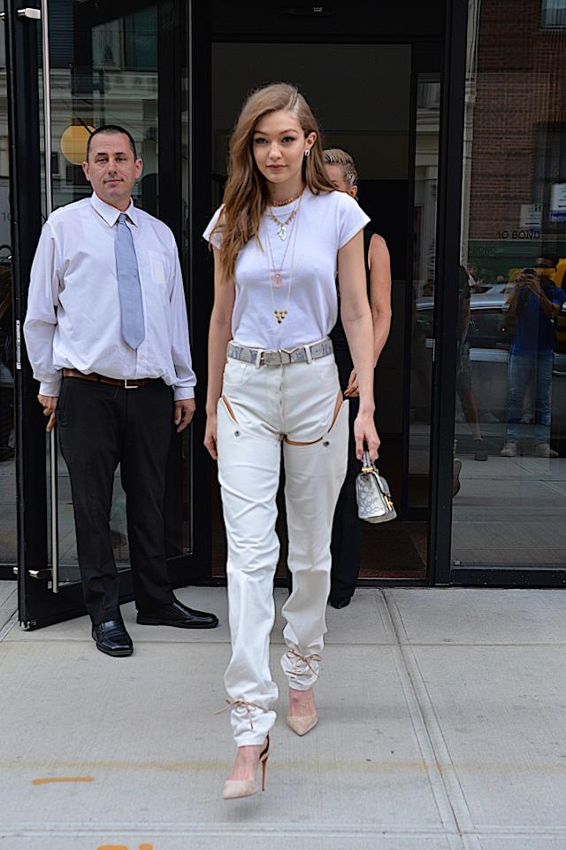 Hadid wearing <span>$332 detachable cut-out side</span>Y/Project jeans are available at Opening Ceremony.