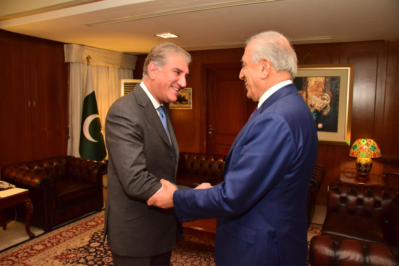 In this photo released by the Foreign Office, Pakistan's Foreign Minister Shah Mahmood Qureshi, left, receives U.S. envoy Zalmay Khalilzad at the Foreign Ministry in Islamabad, Pakistan, Friday, Jan. 18, 2019. Khalilzad has met with Pakistan's foreign minister on the second day of his visit to Islamabad as part of efforts to find a peaceful solution to neighboring Afghanistan's 17-year war.(Pakistan Foreign Office, via AP)
