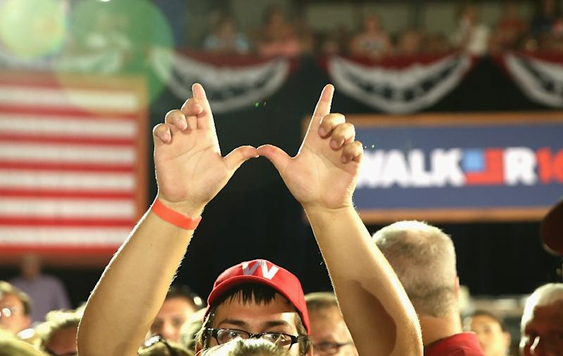 Supporters of Wisconsin Governor Scott Walker wait at the Waukesha County Expo Center for him to announce that he will seek the Republican nomination for president, on July 13, 2015 (AFP Photo/Scott Olson)