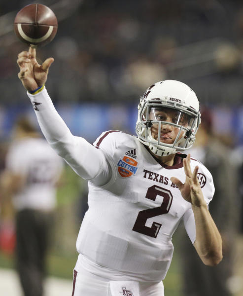 Texas A&M quarterback Johnny Manziel warms up before the Cotton Bowl NCAA college football game against Oklahoma at Cowboys Stadium on Friday, Jan. 4, 2013, in Irving, Texas. (AP Photo/LM Otero)