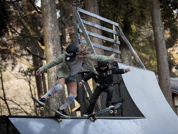 Sky Brown (L) and her brother Ocean (R) show their skateboarding skills on the half-pipe at a park in Kijo town, Miyazaki in 2018.