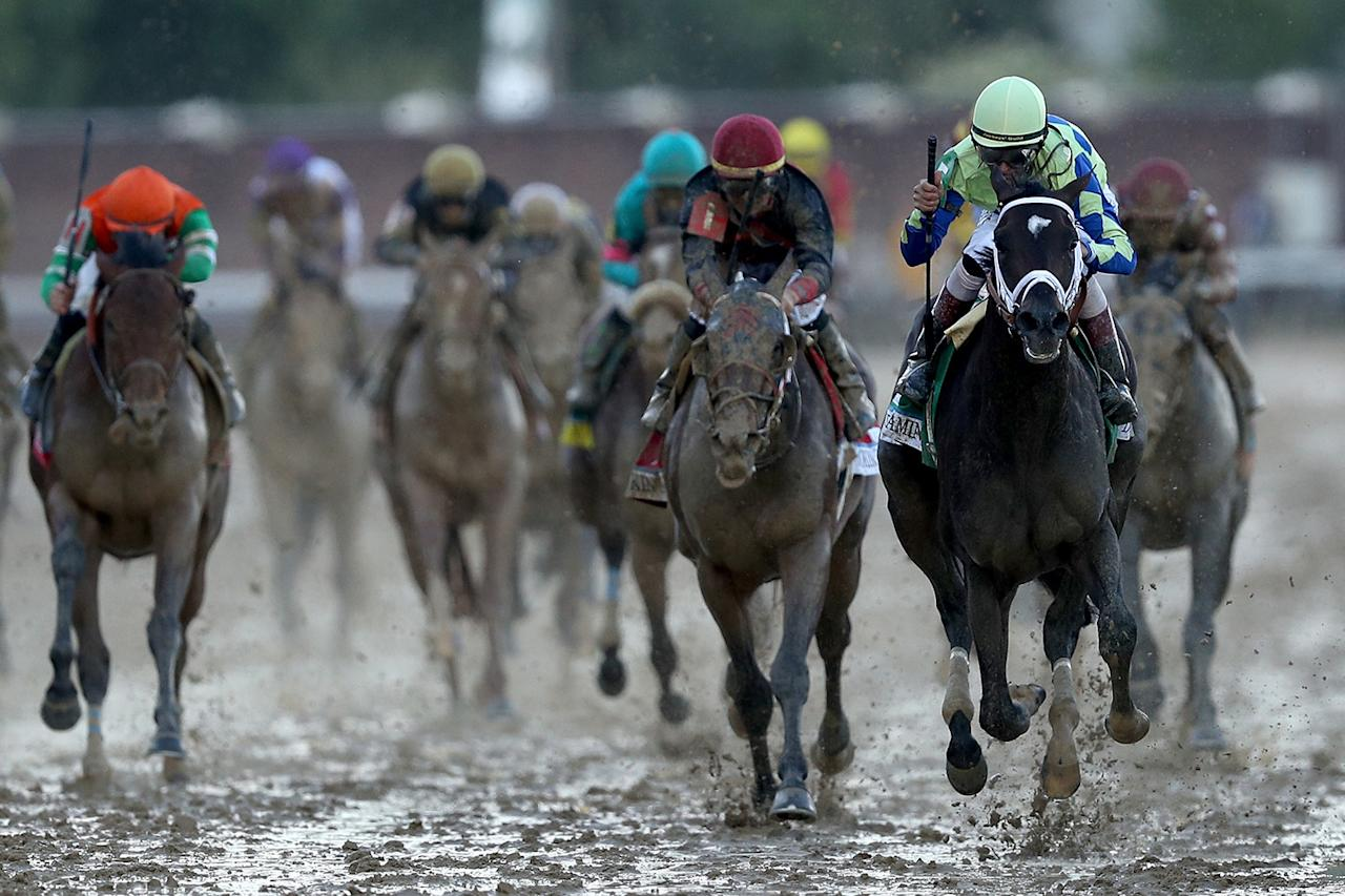 <p>Jockey John Velazquez celebrates as he guides Always Dreaming (5) across the finish line to win the 143rd running of the Kentucky Derby at Churchill Downs on May 6, 2017 in Louisville, Kentucky. (Photo: Patrick Smith/Getty Images) </p>