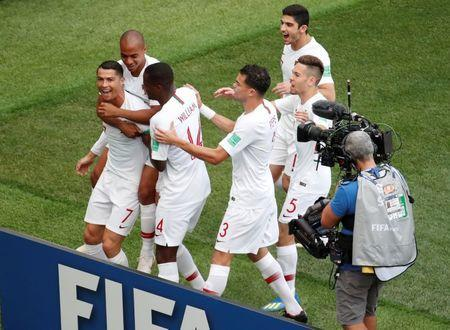 Soccer Football - World Cup - Group B - Portugal vs Morocco - Luzhniki Stadium, Moscow, Russia - June 20, 2018 Portugal's Cristiano Ronaldo celebrates with team mates after scoring their first goal REUTERS/Christian Hartmann