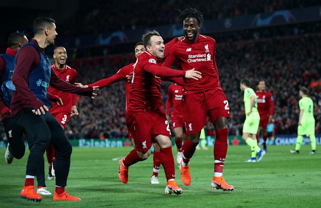 Divock Origi and Xherdan Shaqiri lead the celebrations as the former puts Liverpool ahead.