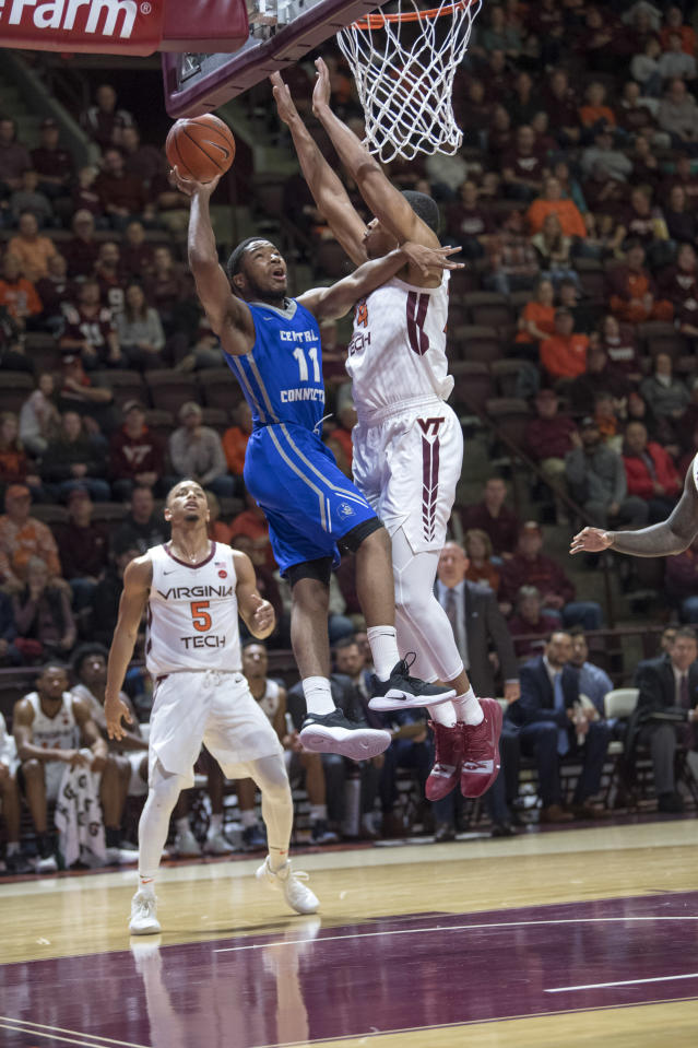 Central Connecticut State guard Thai Segwai (11) goes up for a basket against Virginia Tech forward Kerry Blackshear Jr. (24) during the first half of an NCAA college basketball game Saturday, Dec. 1, 2018, in Blacksburg, Va. (AP Photo/Don Petersen)