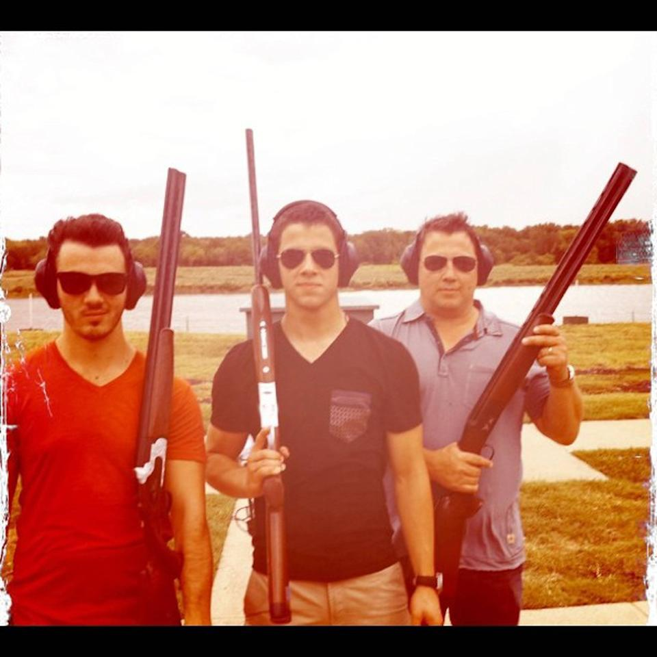 Nick Jonas posted this image of himself and Kevin Jonas on Instagram with the caption 'Gun range with @kevinjonas & @papajonas' credit: Nick Jonas/Instagram  03.07.12 Supplied by WENN.com  (WENN does not claim any Copyright or License in the attached material. Any downloading fees charged by WENN are for WENN's services only, and do not, nor are they intended to, convey to the user any ownership of Copyright or License in the material. By publishing this material, the user expressly agrees to indemnify and to hold WENN harmless from any claims, demands, or causes of action arising out of or connected in any way with user's publication of the material.)