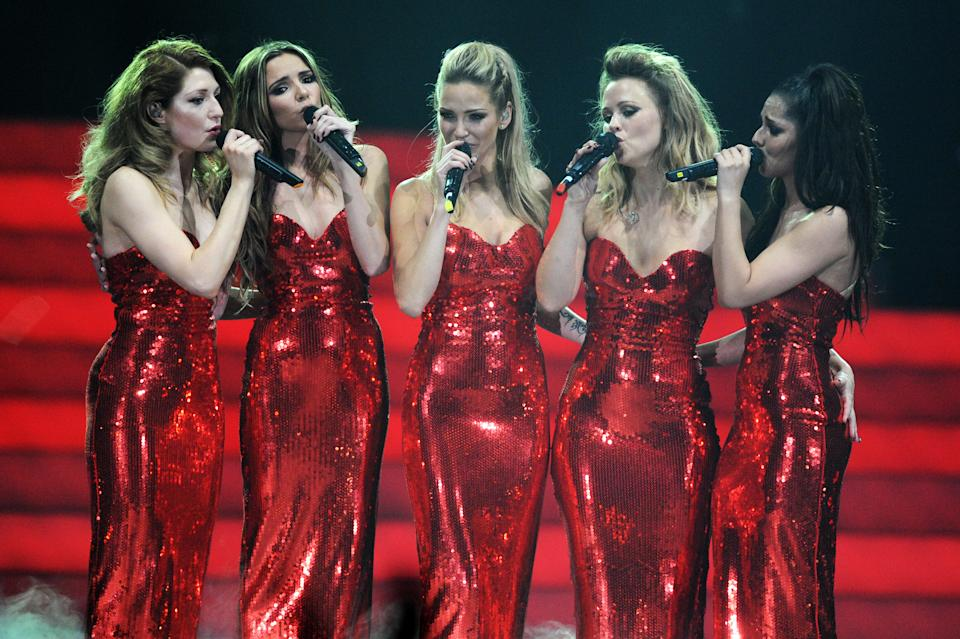 NEWCASTLE UPON TYNE, ENGLAND - FEBRUARY 21:  (MINIMUM FEES APPLY OF GBP150 PRINT OR GBP75 WEB)(EXCLUSIVE COVERAGE) Kimberley Walsh, Nicola Roberts, Nadine Coyle, Cheryl Cole and Sarah Harding of Girls Aloud perform on stage on the first night of their