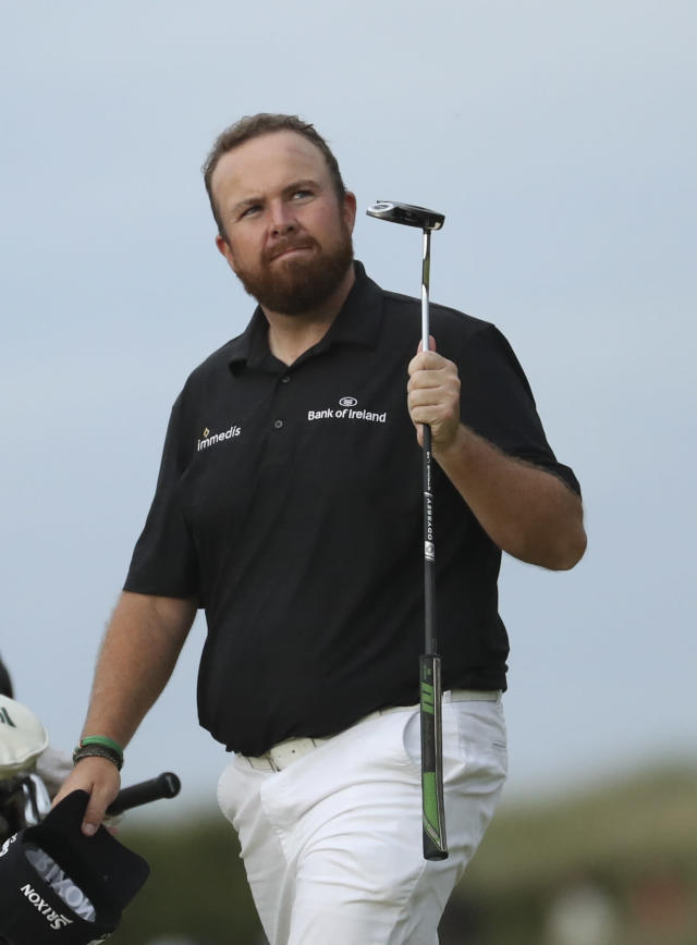 Ireland's Shane Lowry acknowledges the crowd as he walks onto the 18th green during the third round of the British Open Golf Championships at Royal Portrush in Northern Ireland, Saturday, July 20, 2019.(AP Photo/Peter Morrison)