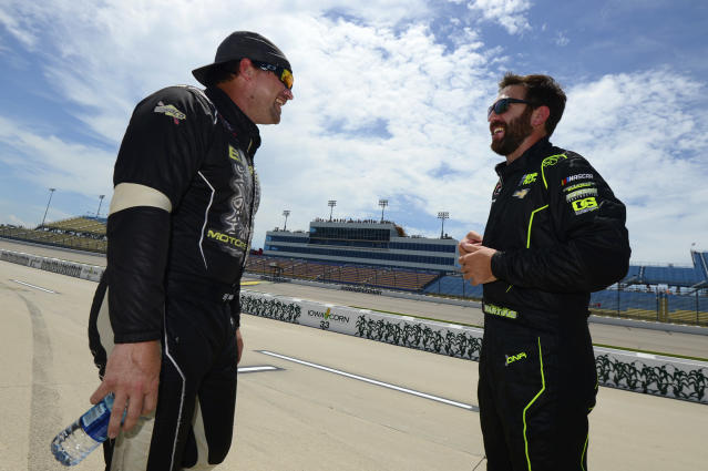McLeod (L) and Martins chat before qualifying at Iowa Speedway. (Getty Images)