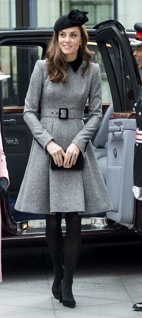 For a visit to King's College to officially open Bush House alongside the Queen, the Duchess of Cambridge dressed in a chic grey Catherine Walker coat dress. She finished the ensemble with her favourite Mulberry clutch along with a Lock & Co hat. [Photo: Getty]