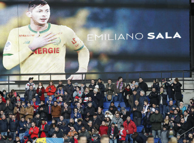 Tributes are paid to Emiliano Sala ahead of the French League One soccer match between Paris Saint-Germain and Bordeaux at the Parc des Princes stadium in Paris, Saturday, Feb. 9, 2019. (AP Photo/Christophe Ena)