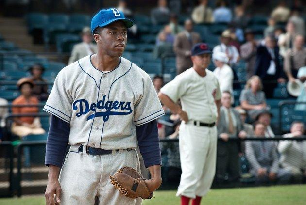 Chadwick Boseman plays Jackie Robinson in '42,' in theaters now