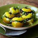 """Stuffed tomatoes get grilling, filled with a mixture of mushrooms and Parmesan cheese. <a href=""""https://www.epicurious.com/recipes/food/views/yellow-tomatoes-stuffed-with-grilled-wild-mushrooms-and-parmesan-cheese-358969?mbid=synd_yahoo_rss"""" rel=""""nofollow noopener"""" target=""""_blank"""" data-ylk=""""slk:See recipe."""" class=""""link rapid-noclick-resp"""">See recipe.</a>"""
