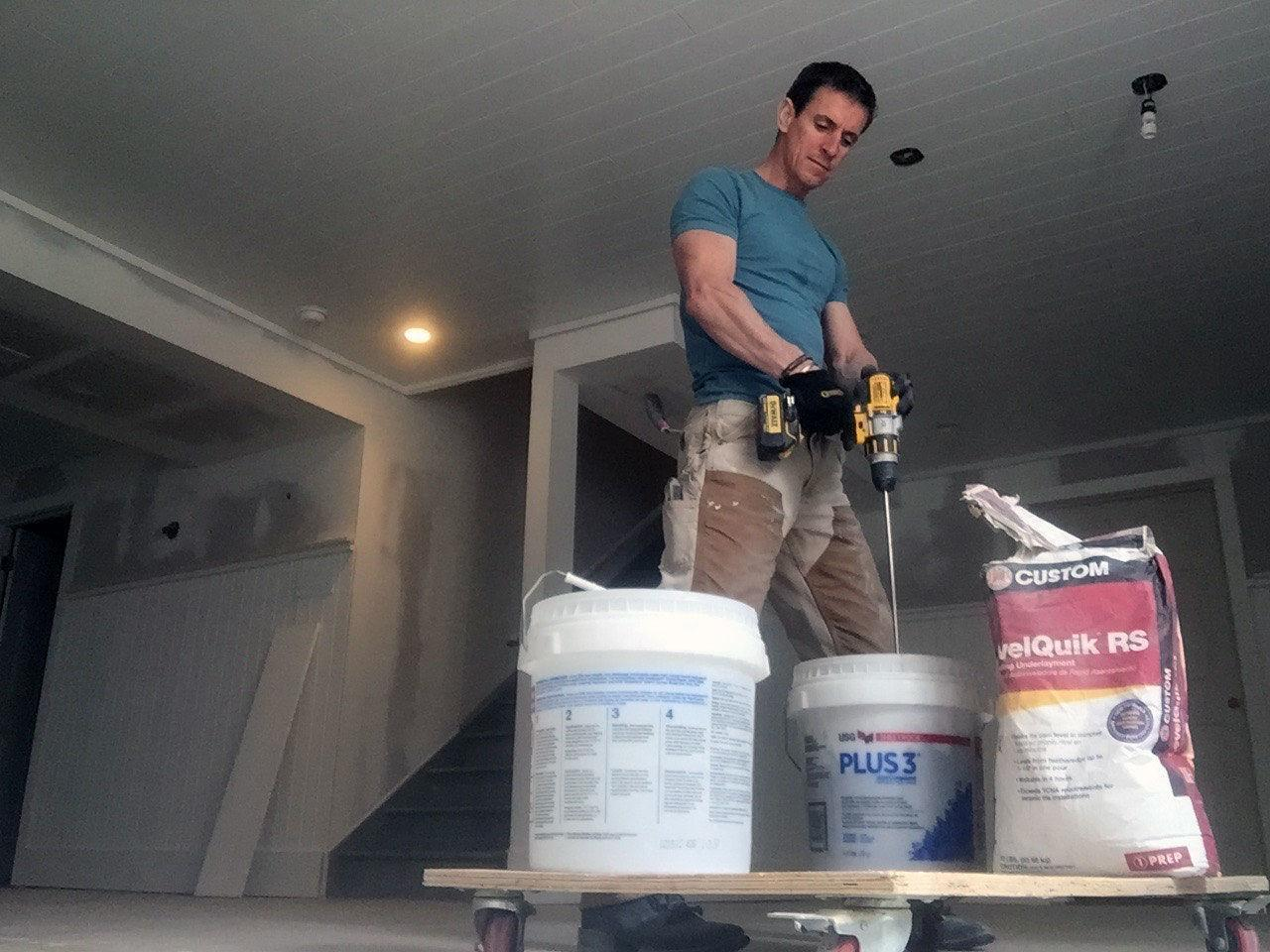 <p>In most remodeling applications we use floor leveler to <i>flatten</i> the floor, not make it level. If your floor has deep pocks or bellies (some people call them 'bird baths') more than a 1/4-inch, mix up some floor leveler and pour it on. The key is getting the right viscosity: A little more viscous than water—but not much. It needs to be fluid enough to flow so gravity can draw it into a low spot. Strike off edges with a flat trowel.</p>