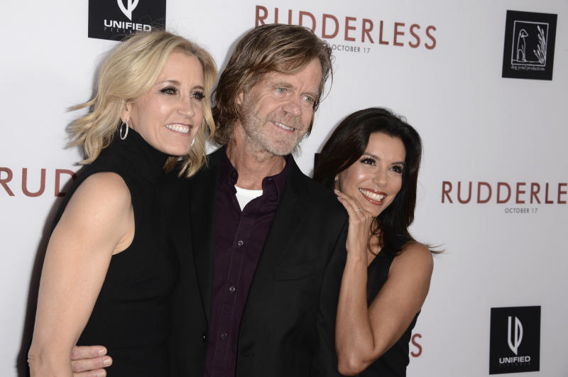 """FILE - In this  Tuesday, Oct. 7, 2014 file photo,Felicity Huffman, from left, writer/director William H. Macy and Eva Longoria arrive at the Los Angeles VIP screening of """"Rudderless"""" at The Vista Theater. Felicity Huffman and her lawyers pleaded Friday, Sept. 6, 2019 for probation, community service and a fine instead of jail time for her role in the college admissions scandal, buoyed by letters of support from her famous husband, William H. Macy, and her """"Desperate Housewives"""" co-star Eva Longoria.(Photo by Dan Steinberg/Invision/AP, File)"""