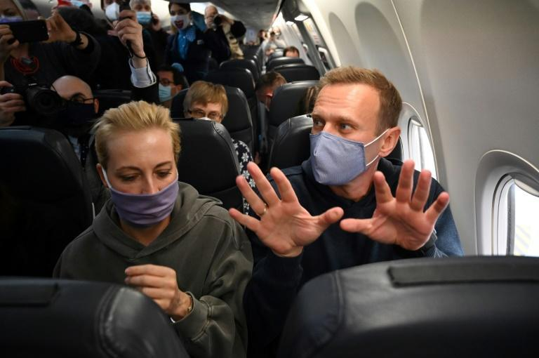 """They will arrest me? That's impossible, I'm an innocent person,"" Navalny said, seated next to wife Yulia on the way back to Russia"