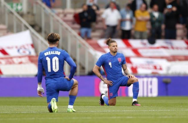 England's Jack Grealish and Kalvin Phillips take a knee before the Romania game