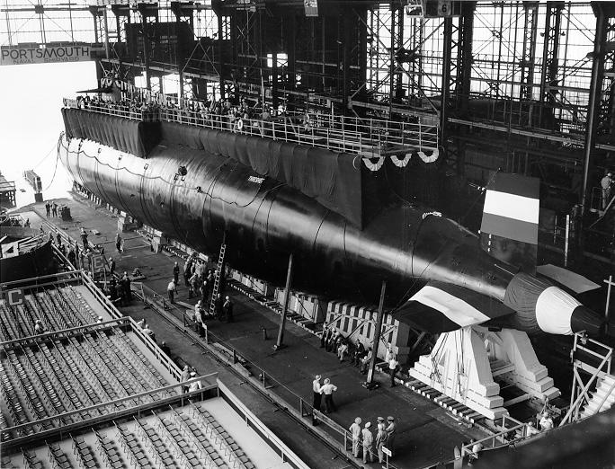 FILE- In this 1960 handout file photo provided by the U.S. Navy, the nuclear-powered submarine USS Thresher is prepared for launching at the Portsmouth Naval Shipyard in Kittery, Maine. Fifty years ago 129 men lost their lives when the sub sank during deep-dive testing off Cape Cod. The deadliest submarine disaster in U.S. history delivered a blow to national pride during the Cold War and became the impetus for safety improvements. (AP Photo/U.S. Navy, file)