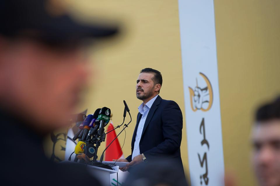 """Hussein Muanis, the leader of a political movement called """"Harakat Huqooq, Arabic for Rights Movement, speaks at a press conference announcing his electoral program for the upcoming parliamentary elections in Baghdad, Iraq, Friday, Sept. 3, 2021. Muanis is the leader of Kataeb Hezbollah, one of the most hard-line and powerful militias with close ties to Iran, who once battled U.S. troops. He is the first to be openly affiliated with Kataeb Hezbollah or Hezbollah Brigades, signaling the militant group's formal entry into politics. (AP Photo/Hadi Mizban)"""