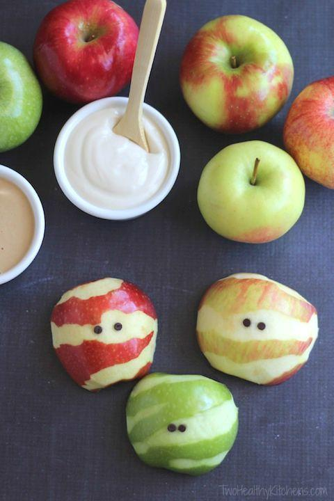 """<p>Delight toddlers and little kids with this easy treat—all you need to do is strategically peel apples. Serve alongside a yogurt fruit dip for added fun. </p><p><a class=""""link rapid-noclick-resp"""" href=""""https://twohealthykitchens.com/apple-mummies-a-healthy-halloween-treat/"""" rel=""""nofollow noopener"""" target=""""_blank"""" data-ylk=""""slk:GET THE RECIPE"""">GET THE RECIPE</a></p>"""