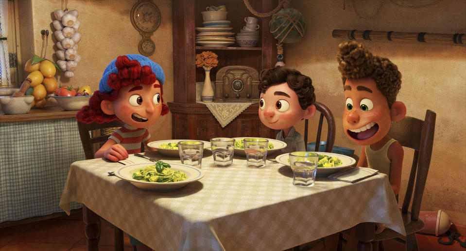 """This image released by Disney shows characters Giulia, voiced by Emma Berman, Luca, voiced by Jacob Tremblay and Alberto, voiced by Jack Dylan Grazer, in a scene from the animated film """"Luca."""" (Disney via AP)"""