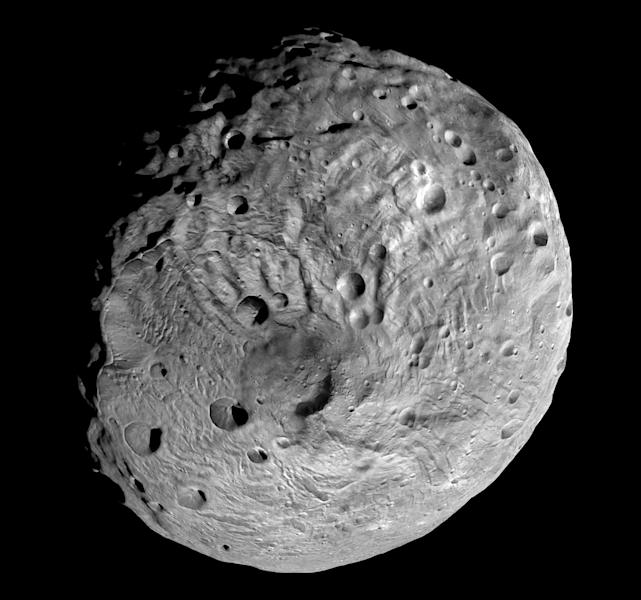 This undated image released by NASA and taken by the NASA Dawn spacecraft shows the south pole of the giant asteroid Vesta. After spending a year examining Vesta, Dawn was poised to depart and head to another asteroid Ceres, where it will arrive in 2015. (AP Photo/NASA)