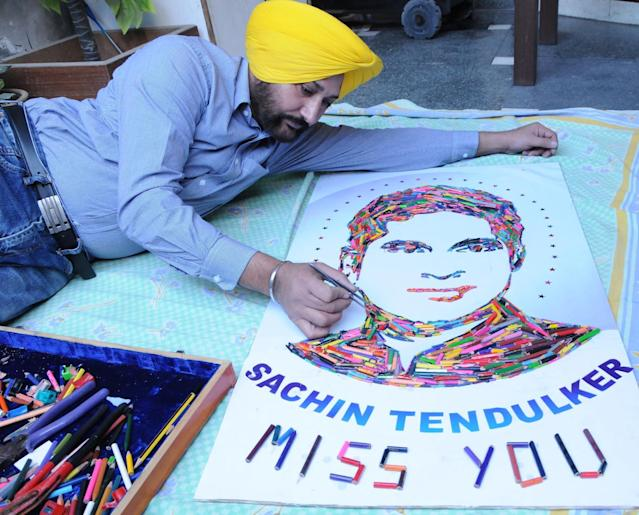 Artist H S Gill with a collage of master blaster Sachin Tendulkar as the cricket legend bid adieu to international cricket after his 200th Test at Mumbai's Wankhede stadium, in Amritsar on Nov.16, 2013. (Photo: IANS)
