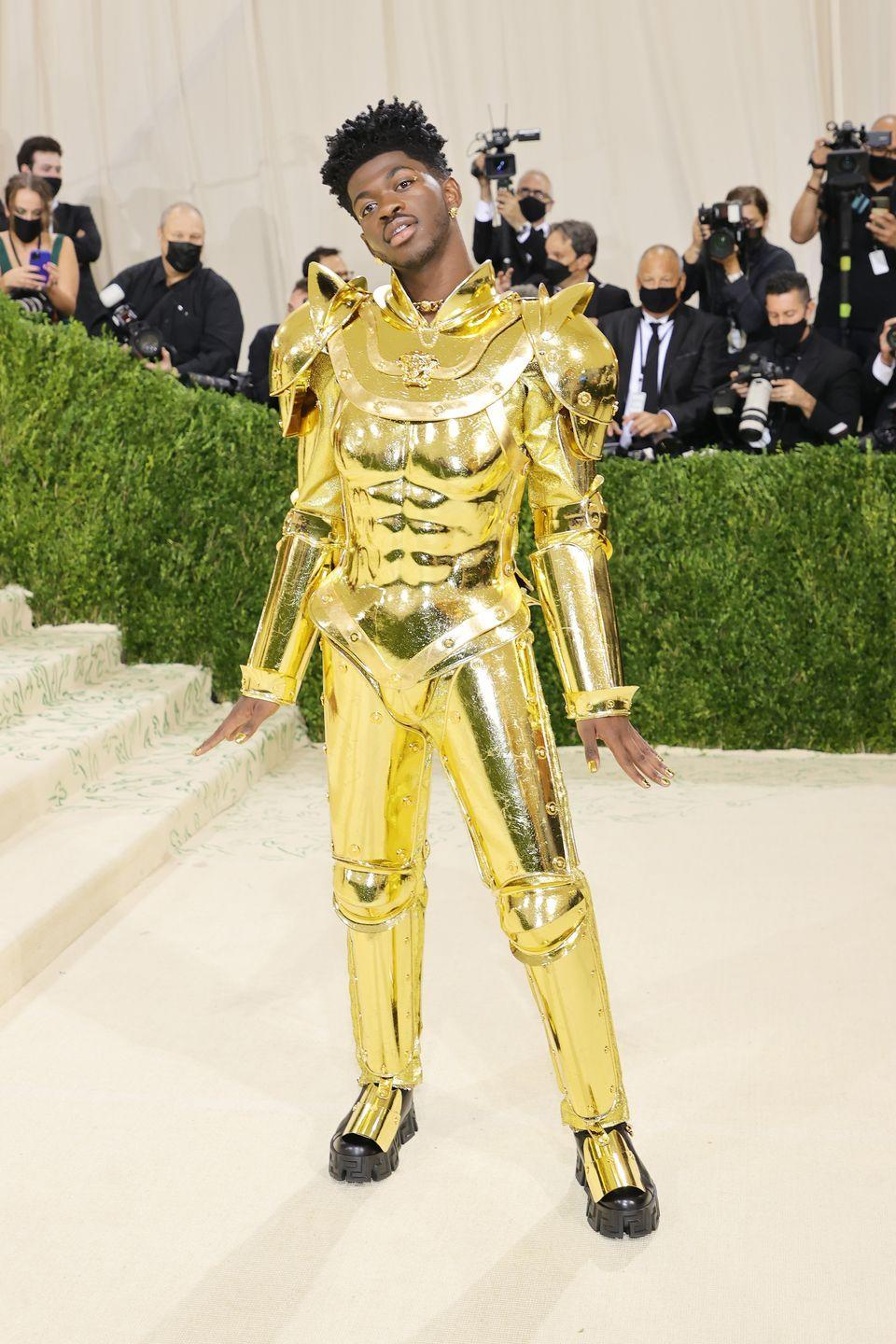 <p>Lil Nas X wore a full suit of gold armour by Atelier Versace to the event.</p>