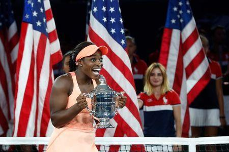 Tennis - US Open - Womens Final - New York, U.S. - September 9, 2017 - Sloane Stephens of the United States reacts with the trophy after defeating Madison Keys of the United States. REUTERS/Mike Segar