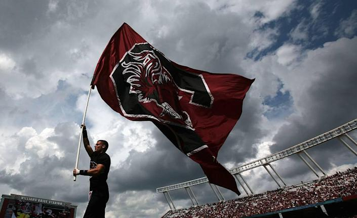 The University of South Carolina flag flies high after the Gamecocks scored against East Carolina in the third quarter at William-Brice Stadium.