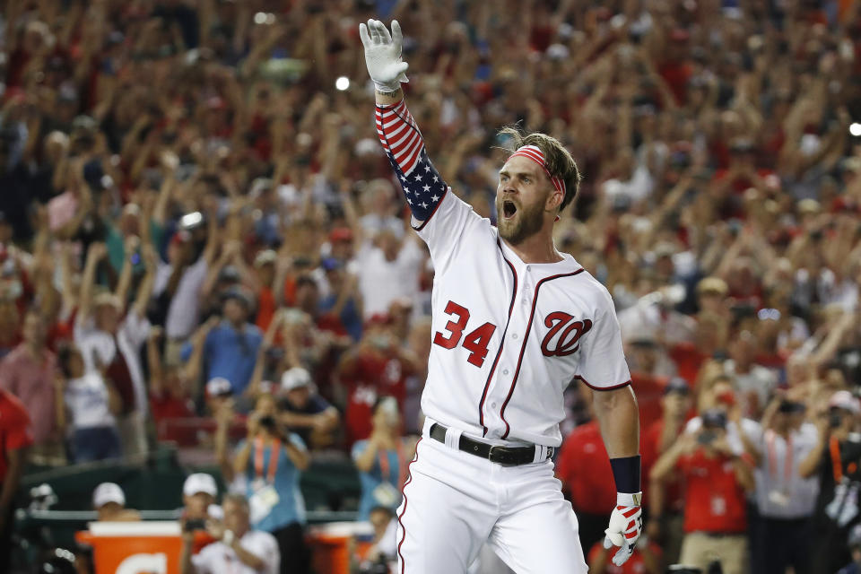 FILE - In this July 16, 2018, file photo, Washington Nationals Bryce Harper (34) reacts to his winning hit during the Major League Baseball Home Run Derby, in Washington. A person familiar with the negotiations tells The Associated Press that Bryce Harper and the Philadelphia Phillies have agreed to a $330 million, 13-year contract, the largest deal in baseball history. The person spoke to the AP on condition of anonymity Thursday, Feb. 28, 2019, because the agreement is subject to a successful physical. (AP Photo/Alex Brandon, File)