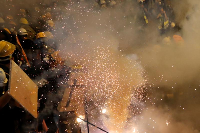 An anti-extradition demonstrators have tear gas fired at them while they clash with riot police, after a march to call for democratic reforms, in Hong Kong, China July 21, 2019. (Photo: Tyrone Siu/Reuters)