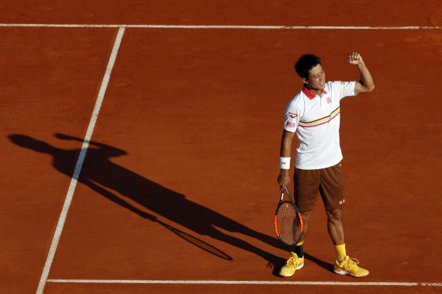 Japan's Kei Nishikori celebrates after defeating Croatia's Marin Cilic during their quarterfinal match of the Monte Carlo Tennis Masters tournament in Monaco, Friday, April, 20, 2018. (AP Photo/Christophe Ena)