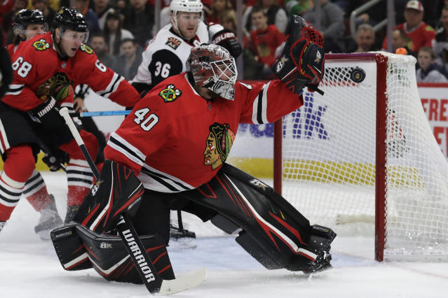Chicago Blackhawks goalie Robin Lehner blocks a shot by Arizona Coyotes center Christian Dvorak during the first period of an NHL hockey game Sunday, Dec. 8, 2019, in Chicago. (AP Photo/Nam Y. Huh)