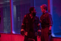"""This image released by Warner Bros. Entertainment shows Robert Pattinson, right, and John David Washington in a scene from """"Tenet."""" Warner Bros. says it is delaying the release of Christopher Nolan's sci-fi thriller """"Tenet"""" until Aug. 12. (Melinda Sue Gordon/Warner Bros. Entertainment via AP)"""