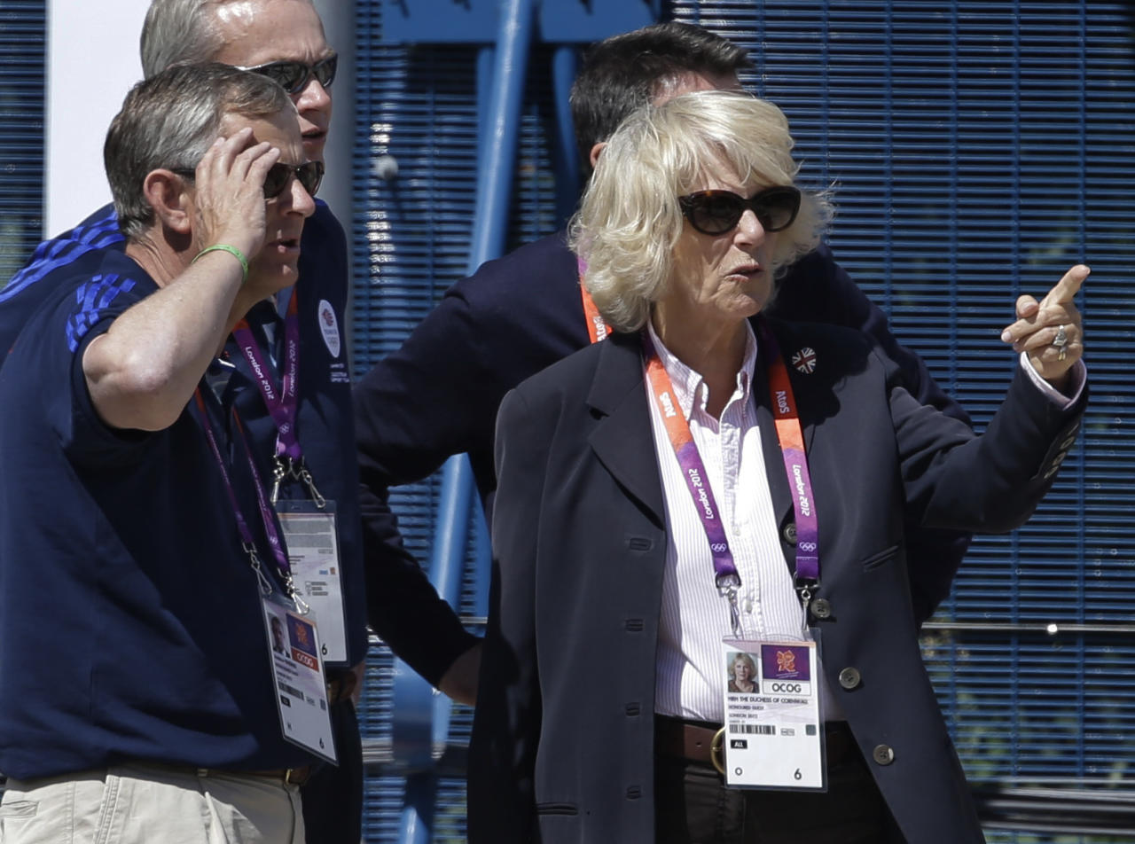Camilla, Duchess of Cornwall, watches the equestrian eventing cross country phase at the 2012 Summer Olympics, Monday, July 30, 2012, in London. (AP Photo/David Goldman)