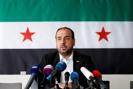 FILE PHOTO -  Nasr al-Hariri, Head of the Syrian Negotiation Commission, speaks at a news conference in Brussels