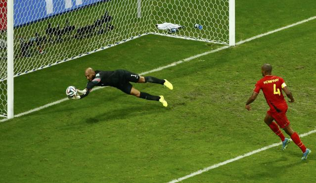 Goalkeeper Tim Howard of the U.S. saves a shot during their 2014 World Cup round of 16 game against Belgium at the Fonte Nova arena in Salvador July 1, 2014. REUTERS/Ruben Sprich (BRAZIL - Tags: SOCCER SPORT WORLD CUP)