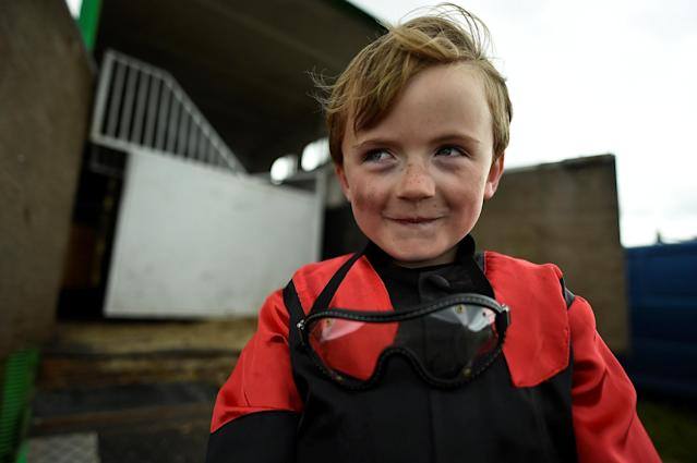 Jockey Aidan Og Gallagher, aged seven, poses for a photograph before a race meet on the beach in Carrowniskey, Ireland June 25, 2017. REUTERS/Clodagh Kilcoyne