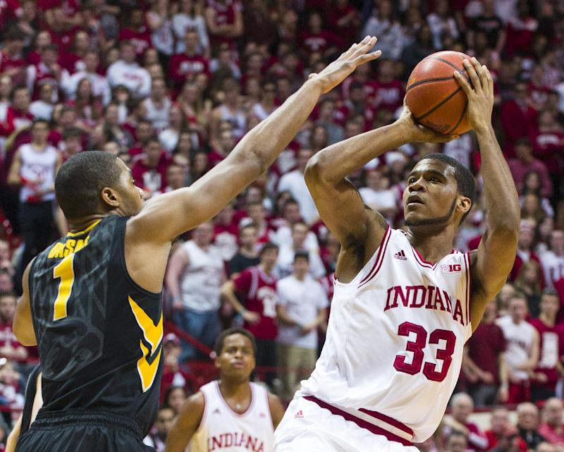 Indiana's Jeremy Hollowell (33) puts up a shot over the defense of Iowa's Melsahn Basabe (1) in the second half of an NCAA college basketball game, Thursday, Feb. 27, 2014, in Bloomington, Ind. Indiana defeated Iowa 93-86