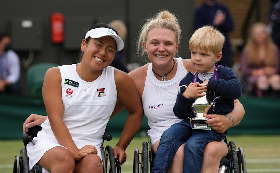 Yui Kamiji of Japan and Jordanne Whiley of Great Britain and her son celebrate with the trophy  (Getty Images)
