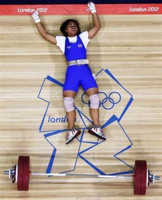 Thailand's Rattikan Gulnoi falls after failed attempt on the women's 58Kg Group A weightlifting competition at the London 2012 Olympic Games July 30, 2012.