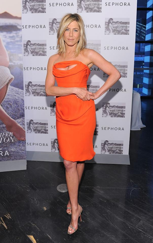 <p>The actress certainly stood out in this bright orange ruched number. <i>[Photo: Getty]</i> </p>